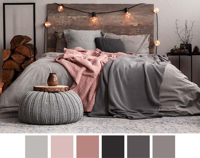 Серая уютная спальня с розовым покрывалом.